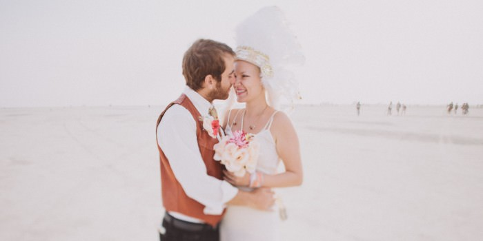 A sunrise wedding in the desert at Burning Man